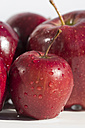 Red apples with waterdrops on white ground - YFF000040