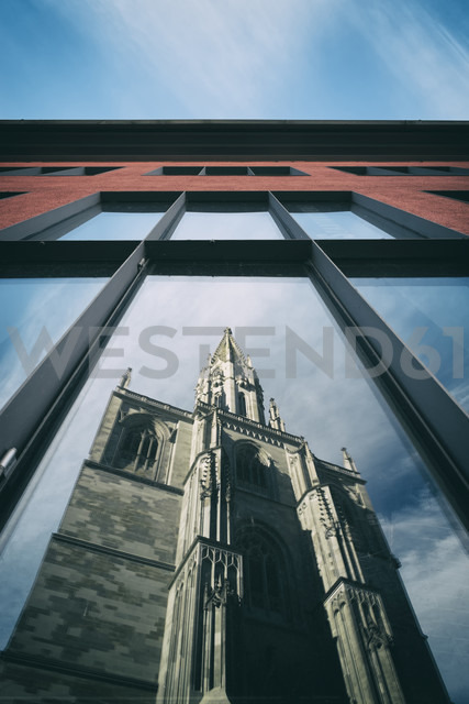 Germany, Baden-Wuerttemberg, Constance district, Constance, Konstanz Minster mirrored in window of library - ELF000863
