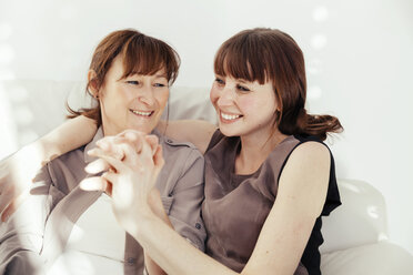 Portrait of mother and daughter laughing together - MFF000901