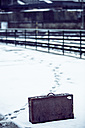 Old suitcase standing in snow on platform - NG000088