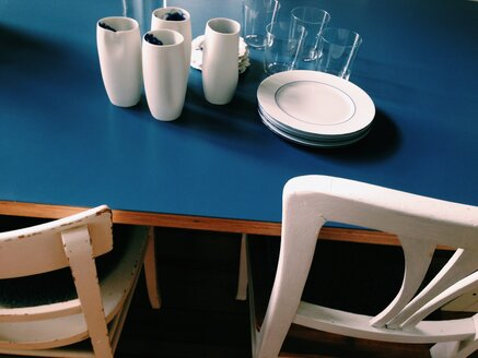Chairs and blue table set with different cups, glasses and plates - MEAF000139