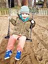 Little boy on a swing on playground, Bonn, North Rhine-Westphalia, Germany - MEAF000202