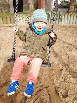 Little boy on a swing on playground, Bonn, North Rhine-Westphalia, Germany - MEAF000202