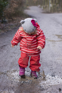 Toddler playing with a puddle of mud - IPF000033