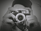 Austria, Mondsee, man taking pictures with analog camera - WV000453