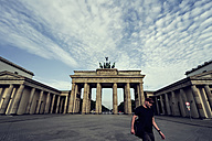 Germany, Berlin, view to Brandenburger Tor with tourist in front - PAF000443