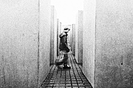 Germany, Berlin, view to Holocaust Memorial with boy going through - PA000428