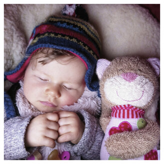 baby sleeping with Plush Toy Cat - IPF000045
