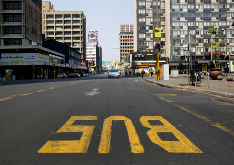 South Africa, Johannesburg, Street in downtown with bus line - TKF000289