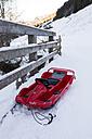 Austria, Tyrol, Alpbach, Bobsleigh in wintertime at a brigde - TK000299