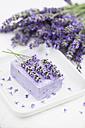 Lavender (Lavendula) on white towel, lavender soap on soap basket - GWF002622