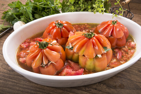 Filled beefsteak tomatoes in a gratin dish, raw, Low Carb - CSTF000076
