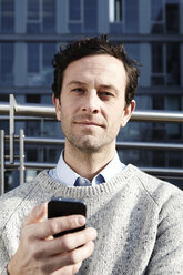 Serious looking man with smartphone - FMK000967