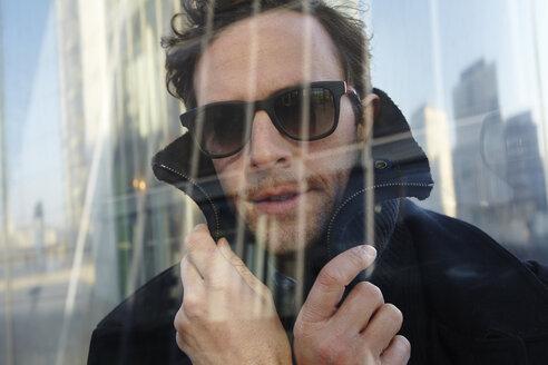 Portrait of man wearing sunglasses - FMK000985