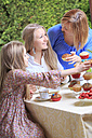 Mother and her two daughters eating muffins - VTF000105