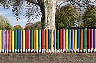 Germany, North Rhine-Westphalia, Duesseldorf-Niederkassel, coloured fence of kindergarten - VI000231