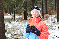 Smiling teenage girl wearing colourful winter clothes having a break - VTF000114