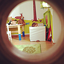 View through peephole into child's room with playing toddler - AFF000028