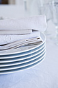 Stack of plates and cloth napkins, partial view - LVF000777