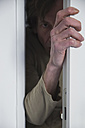 Man looking man opening door - MUF001459