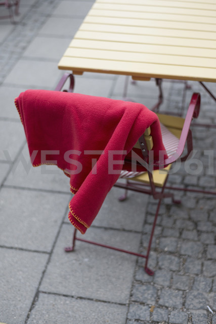 Chair with blanket in pedestrian area - HLF000411