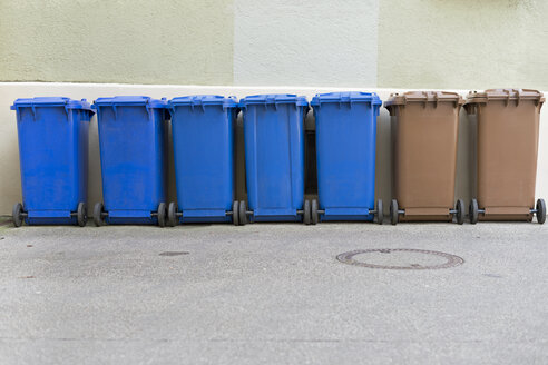 Row of blue and brown garbage cans - HLF000413