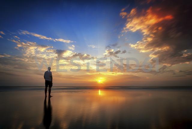 USA, Florida, New Smyrna Beach, man at sunrise - SMAF000198