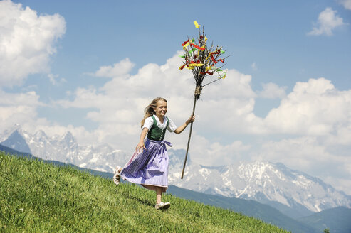 Austria, Salzburg State, Altenmarkt-Zauchensee, girl with Palmbusch running down alpine meadow - HHF004770