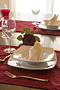 Place setting on festive laid table - SARF000299