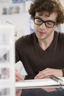Portrait of young architect working in his office - FKF000427