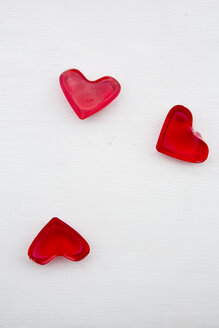 Three red hearts shaped of cherry jelly on white ground - LVF000798