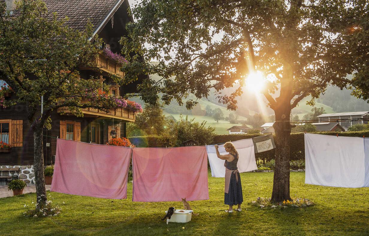Austria, Radstadt, Farm, Female farmer hangs the washing on the line - HHF004781 - Hans Huber/Westend61