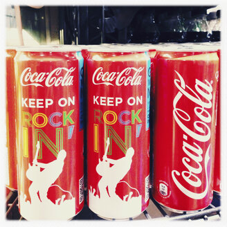 Coke cans labeled