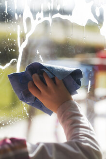 Hand of girl cleaning window - SARF000314