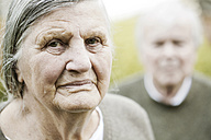 Portrait of senior woman with husband in the background - JATF000713