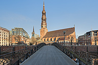 Germany, Hamburg, old warehouse district, Speicherstadt with St Catherine's church at sunrise - RJF000012
