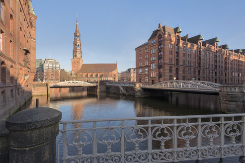 Germany, Hamburg, old warehouse district, Speicherstadt with St Catherine's church at sunrise - RJF000020