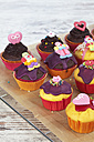Decorated muffins in muffin papers on cooling grid - CSF020945