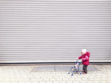 Toddler with doll carriage, Munich, Bavaria, Germany - GSF000784