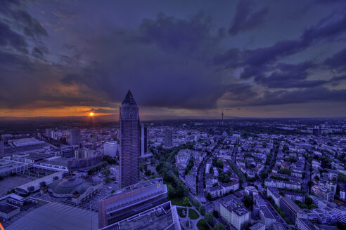 Germany, Hesse, Frankfurt am Main, Trade Fair Tower and city view at sunset - MPA000010