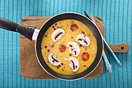 Frittata with champignon, ham cubes and tomatos in frying pan - CSTF000131