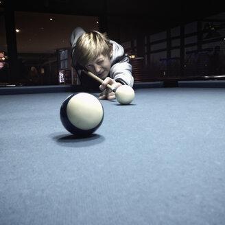 Twelve year old boy playing pool billiard, Hamburg, Germany - SEF000625