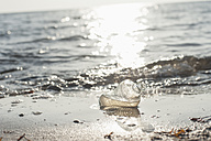 Germany, Mecklenburg-Western Pomerania, Ruegen, glass bottle on the beach - MJF000910