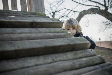 Germany, Mecklenburg-Western Pomerania, Ruegen, little boy at playground - MJF000938