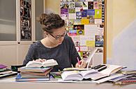 Female pupil doing homework - BTF000325
