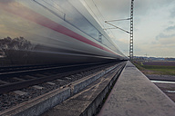 Germany, fast moving train in landscape - HC000021