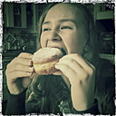 Teenage girl biting into a donut, Schirmitz, Bavaria, Germany - SARF000342