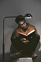 Man reading a book at home - EBSF000075