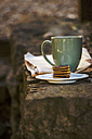 Coffee Cup, plate of chocolate cookies and newspaper on stone step - EBSF000078