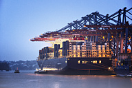 Germany, Hamburg, Container ship at Port of Hamburg in the evening - ROM000004